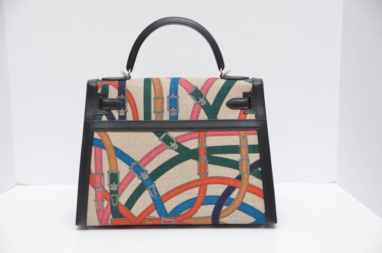 This very limited edition and brand new 'Cavalcadour' print Kelly Bag comes in washed canvas called 'Toile de Camp' in  black swift leather  and palladium hardware. This Kelly in Sellier style has tonal stitching. The interior is made out of one