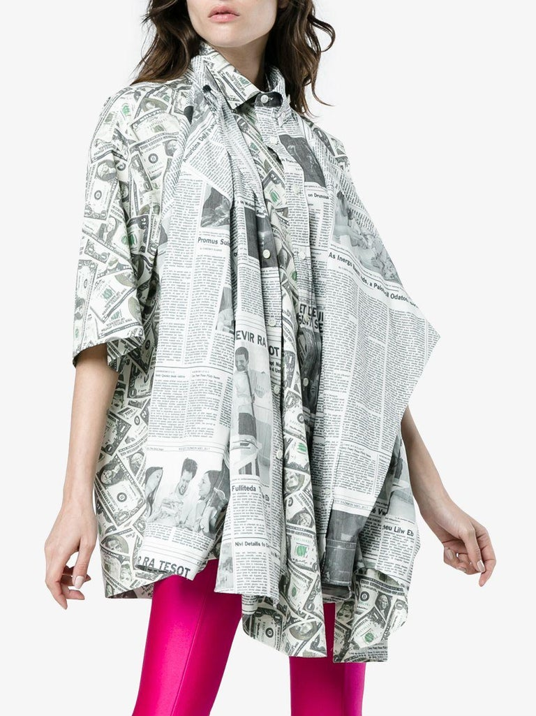 Balenciaga oversized long sleeve poplin shirt featuring  dollar and newspaper  graphic pattern. Runway model.Its actually a double shirt:Dollar print side can be worn as short sleeve with newspaper print sleeves hanging in the front and newspaper