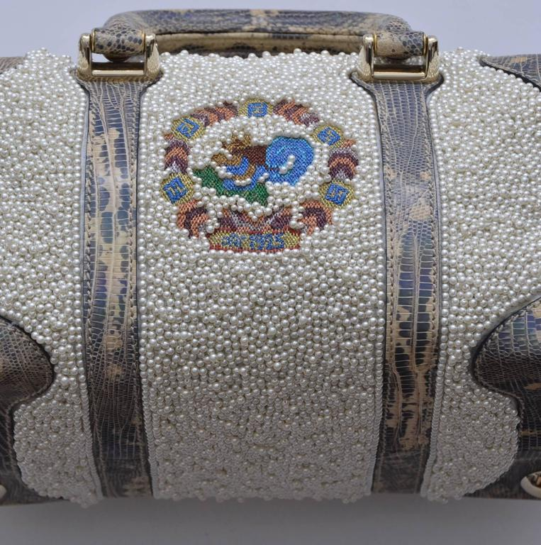 Very special Fendi handbag. Mix lizard skin   fully embellished with faux pearls. Removable shoulder strap.Could be used as carry on mini handbag or cross body .Very beautiful and versatile. Approx. handbag measure: L 11