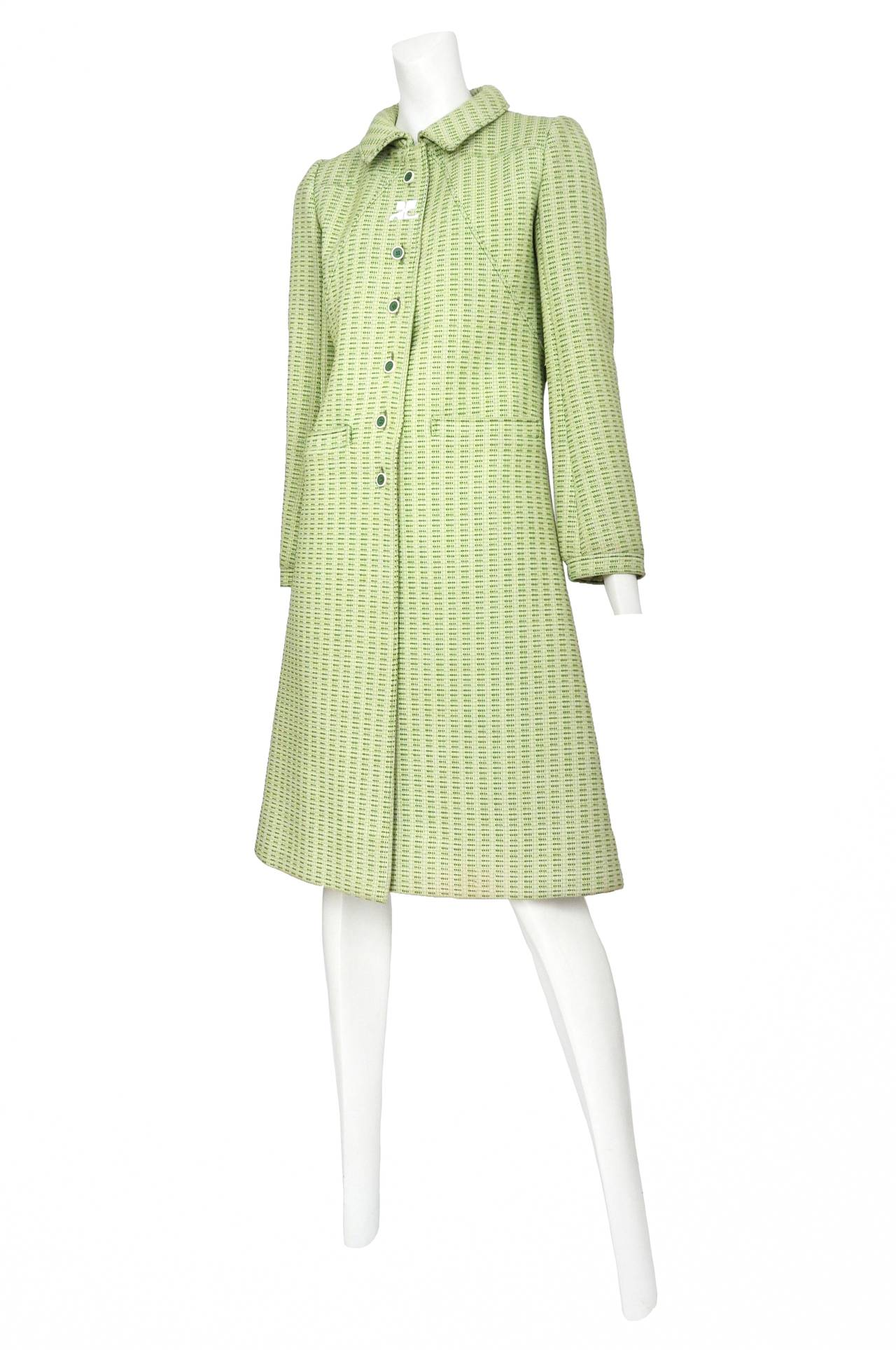 Vintage Andre Courreges pea green textured wool collared coat featuring front waist welt pockets, front torso button closure, defined yoke, back waist belt and white Courreges logo at neck line.