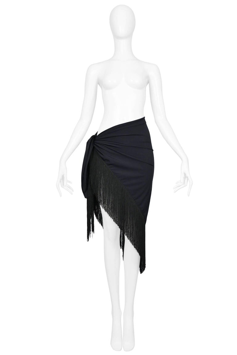 Chic Christian Dior by John Galliano large black beach sarong wrap with heavy fringe. Fabric has some stretch and feels like it would dry quickly. Fabulous over a bikini or one piece. Perfect for the beach or the pool. Never worn.