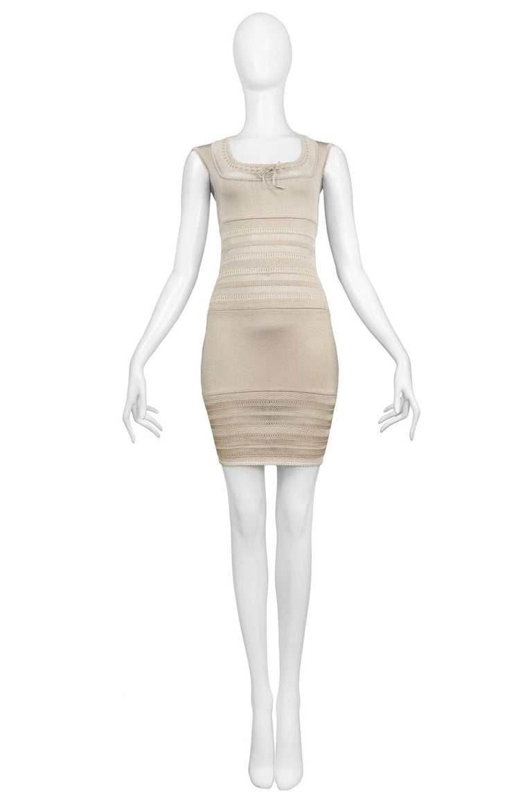 Vintage Azzedine Alaia beige fitted dress with knit lace bodice. Features square neckline, bow at front and zipper at back. The dress fits a today's size 4. Please contact us for measurements.   Excellent Vintage Condition.  Measurements: Bust 30