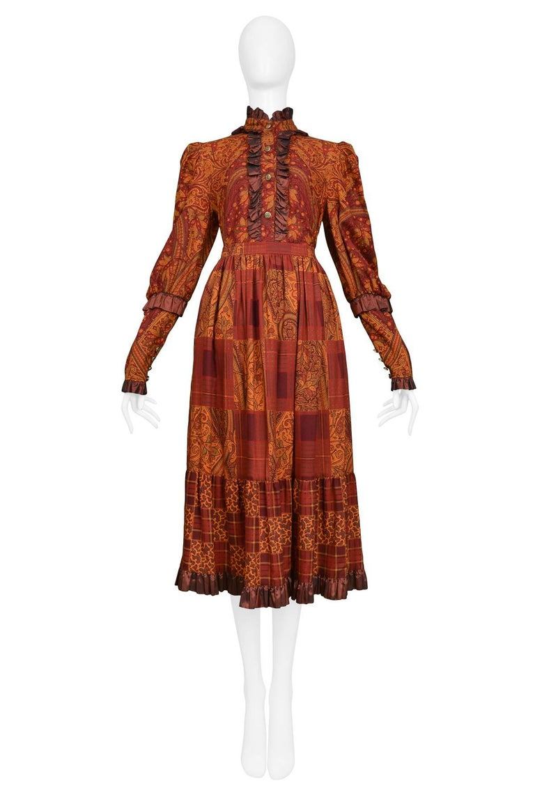 Vintage autumn tone paisley Yves Saint Laurent ruffle blouse with taffeta trim collar, cuffs, hem, and matching skirt.