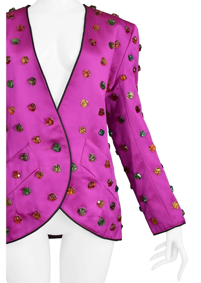 """Outstanding vintage Yves Saint Laurent magenta satin evening jacket with black trim and glass gripoix """"gemstones"""" throughout. Pockets at sides."""