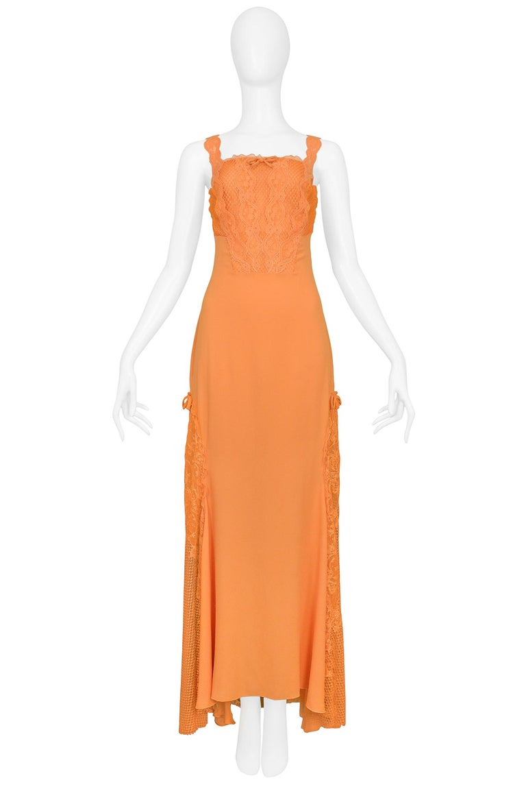 Vintage Gianni Versace apricot orange silk evening gown with lace & net inserts. The gown features bow detailing and rhinestone embellished emblems at straps. Runway piece from the Spring/Summer 1997 Collection.  Excellent Vintage Condition.  Size: