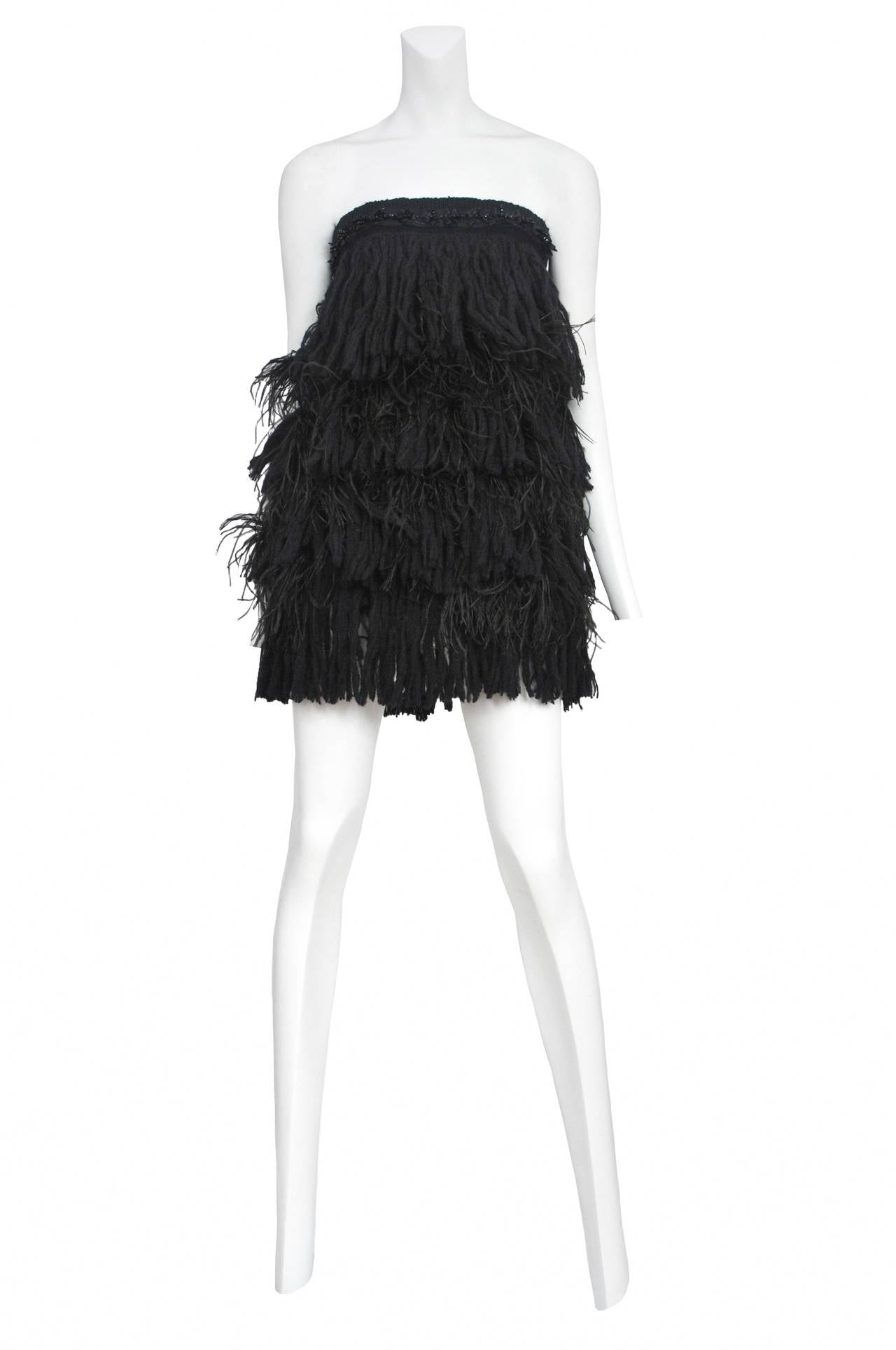 Vintage Christian Lacriox feather and cotton fringe strapless mini with matching leather armbands.