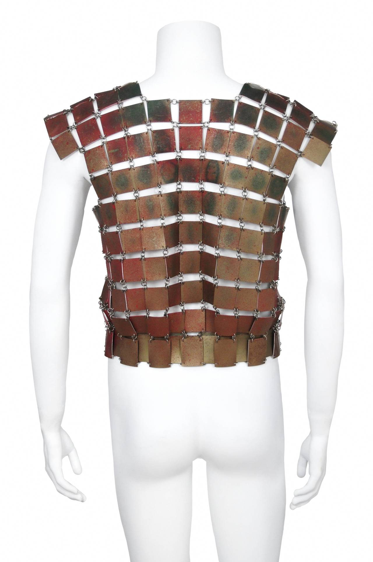 Paco Rabanne early men's short sleeve top featuring metal ring linked bronze leather square cut outs and a built in matching leather waist belt.