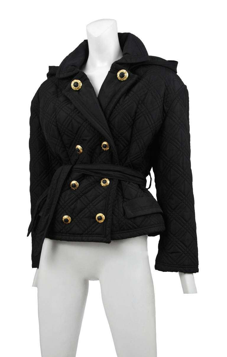 Versace Jeans black double breast quilted jacket with hood. Waist tie closure and gold & black classic Versace buttons