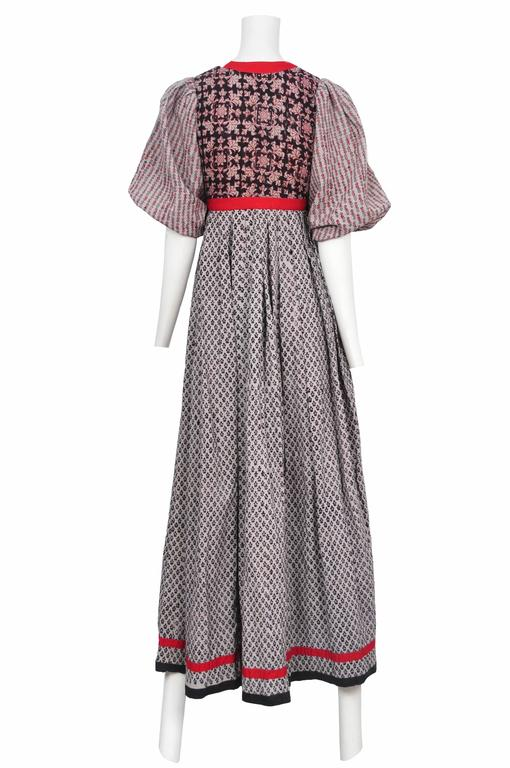 Vintage Thea Porter peasant dress featuring a bohemian chic print, plunging neckline, and empire waist. Circa 1970's.