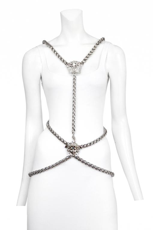 Vintage Versace silver tone chain body harness featuring the designer's signature emblem in the center, front and back.