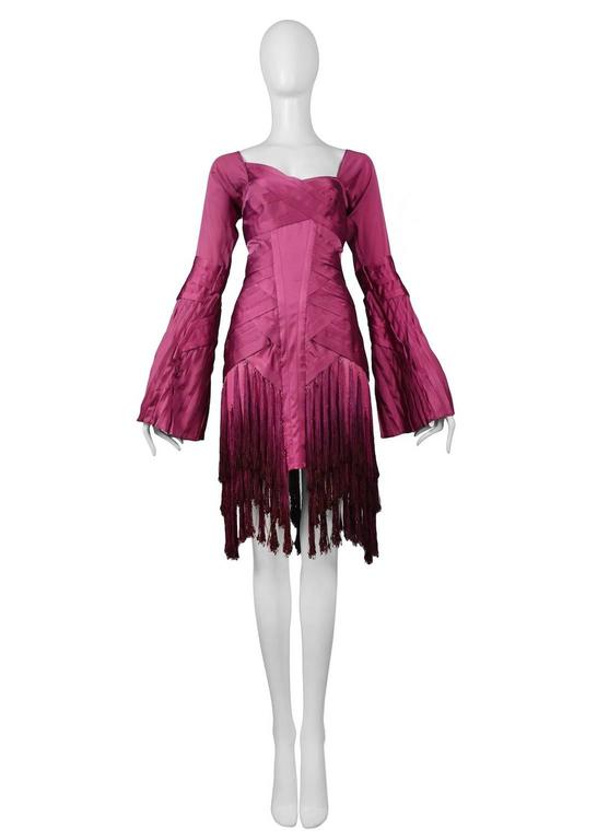 Iconic vintage Tom Ford for Gucci fuchsia silk long sleeve evening dress featuring intricate woven pleating at torso and bust and three tiers of tassels at the skirt. Runway piece from the Fall/Winter 2004 Collection.