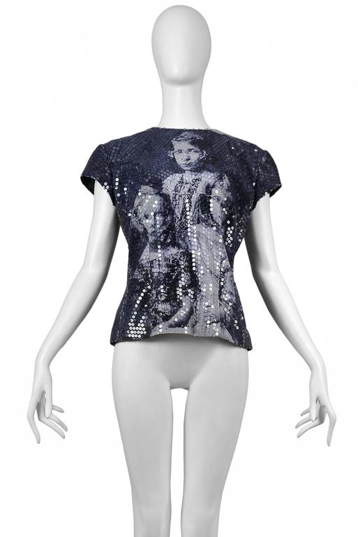 A dark blue top with photographic print of murdered Romanov children covered in clear sequins and zipper at back. Joan collection AW 1998   Please contact for additional images or information.
