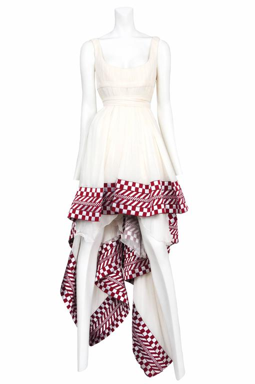 Off white chiffon empire dress with red and white check trim hem. The hem of the dress is short in the front and long in the back. Look #50. Scanners, AW 2003.  Please contact for additional photos or information
