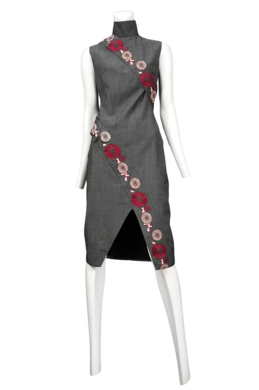 Grey wool chengsom style dress with bands on embroidered flowers. Asymmetrical hem. Voss SS 2001. 