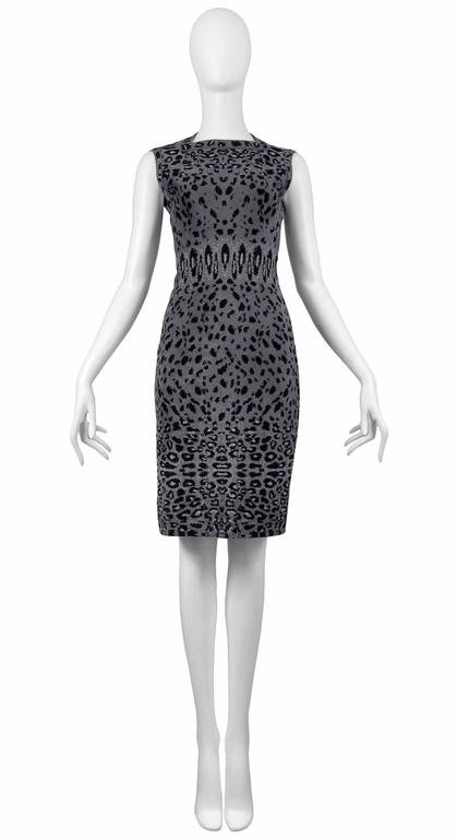 Resurrection Vintage is excited to offer a vintage Azzedine Alaia grey leopard knit dress featuring a high square neckline, tank sleeves with trim, fitted body, straight skirt, knee length, and side zipper.  Alaia Label Size 40 Measurements (flat