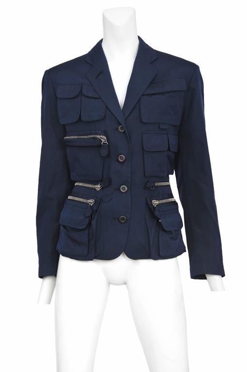 Vintage Jean Paul Gaultier blue utilitarian 4 button blazer featuring multi-sized pockets with and with out zippers covering the front torso and chest.  Please inquire for additional images.
