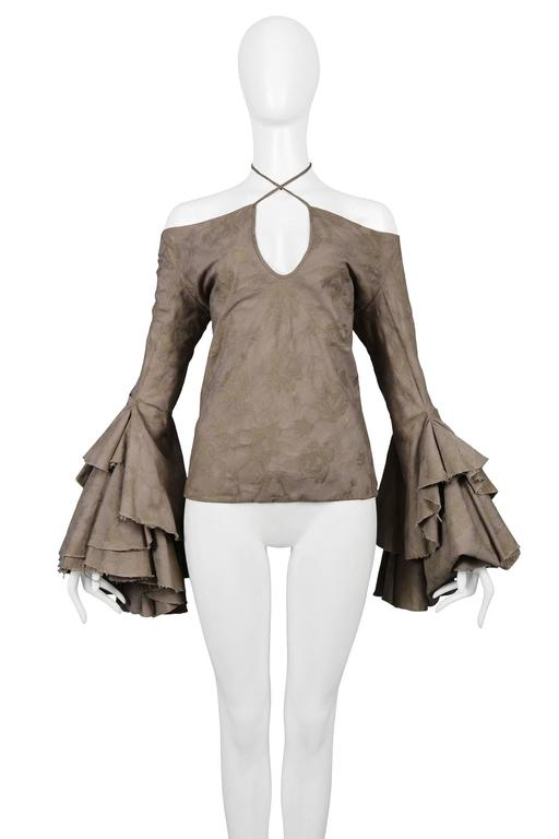 Vintage Alexander McQueen grey off the shoulder top with tonal flower pattern throughout, keyhole neckline, heavily ruffled sleeves, and raw edges. From the Dance Of The Twisted Bull Spring / Summer 2002 Collection. Featured on the runway.   Please