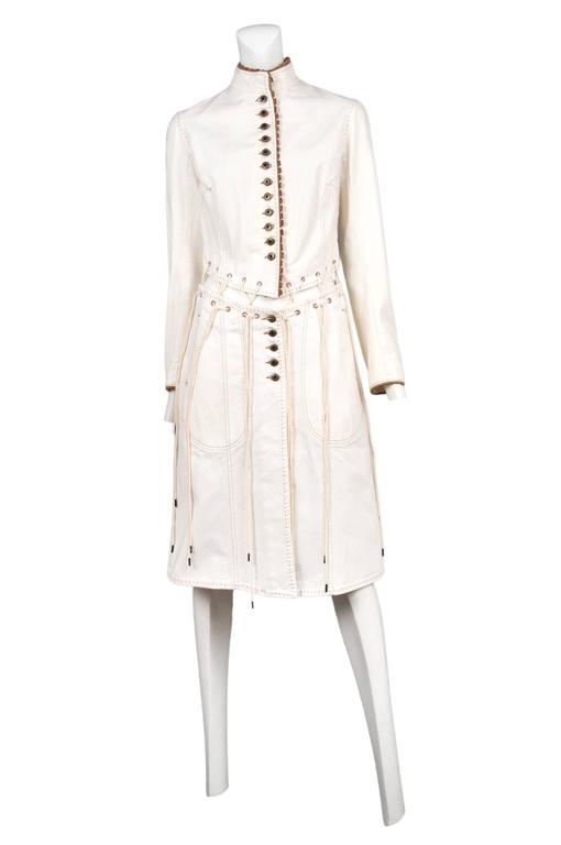 Vintage Alexander McQueen off white denim with brown stitching and Pirate laces coat. Adjustable laces at spine and waist. Button front. From the Irere Spring / Summer 2003 Collection.