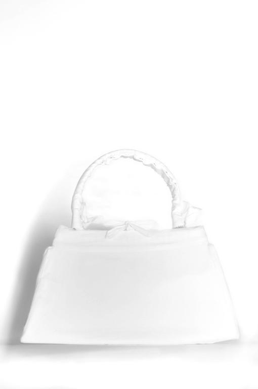 Vintage Maison Martin Margiela artisanal muslin handbag. Handbag is covered with a muslin cloth removable slip cover. Circa Autumn/Winter 2002/2003. Please inquire for additional images.