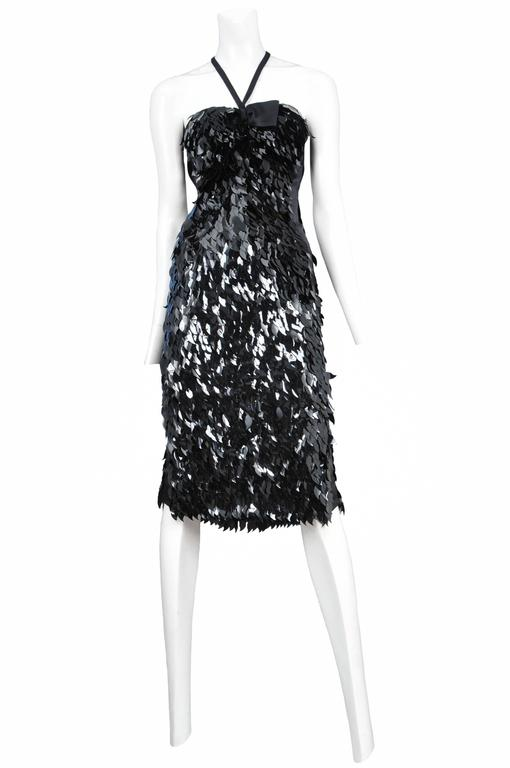 Vintage Tom Ford for Gucci cocktail dress adorned with black leaf shaped paillettes and a ribbon at the top of the bust.