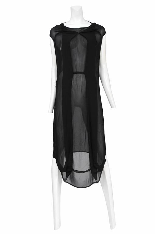 Vintage Maison Martin Margiela black chiffon car seat collection dress. Designed by Martin Margiela prior to the designer's 2009 retirement. Circa 2006.