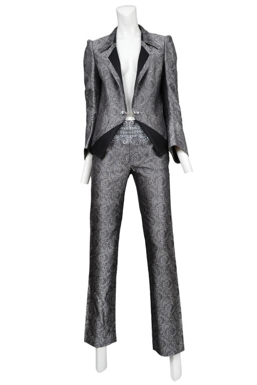 Vintage Nicolas Ghesquière for Balenciaga silver paisley suit featuring a fitted blazer with black trim and chain link buttons and matching pants adorned with a Baroque style print at the upper waist. Runway ensemble from the Spring / Summer 2006