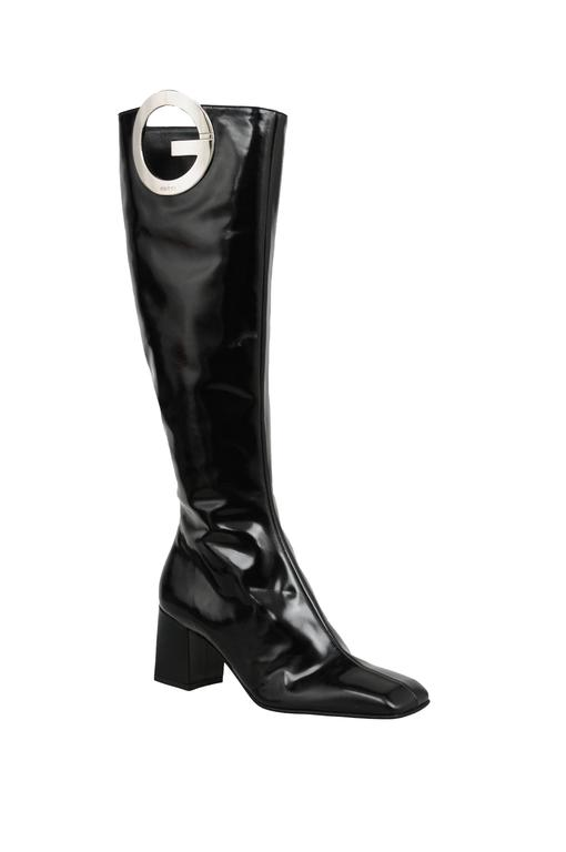 Vintage Tom Ford for Gucci black leather tall boot with silver 'G' logo detail. Zip closure at side.