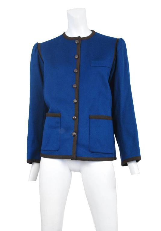 Vintage Yves Saint Laurent blue wool jacket with chocolate brown trim along the edges and pockets. Circa 1970s. Please inquire for additional images.