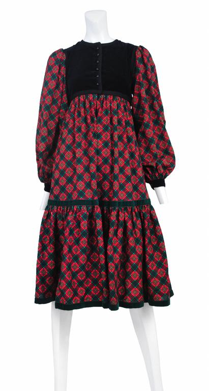 Vintage Yves Saint Laurent pink plaid smock dress featuring a black velvet yoke that closes with a pink plaid bow and black velvet cuffs to match.