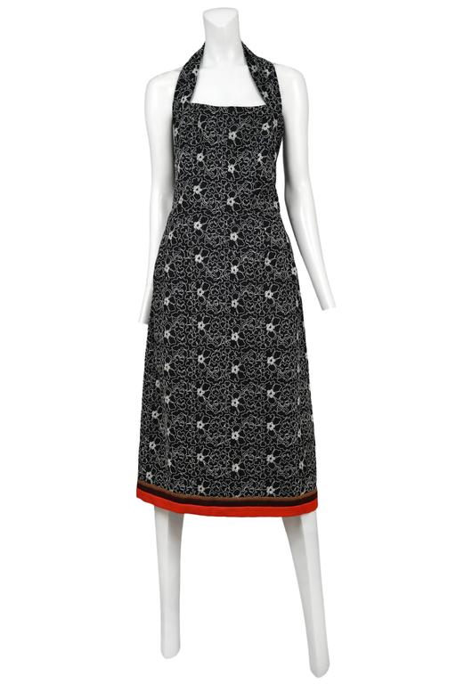Vintage Comme des Garcons black halter dress featuring all over white floral embroidery and red trim at the hem.