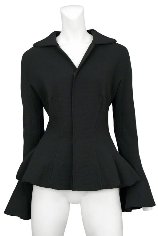 Vintage Yohji Yamamoto black structured jacket featuring bell sleeves, a built in peplum, and darts at the waist.