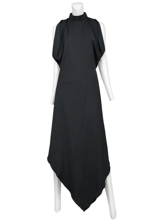 Vintage Maison Martin Margiela black long priestess gown featuring draped arm holes and a stiff priest like collar. Circa Autumn / Winter 2008.