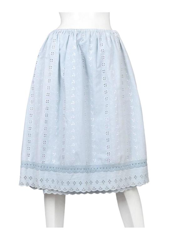 Vintage Maison Martin Margiela light blue eyelet lace artisanal skirt made from two vintage lace skirts, one side is covered in a light blue eyelet pattern and the other side in white with a light blue eyelet trim at the hem. Circa Spring / Summer