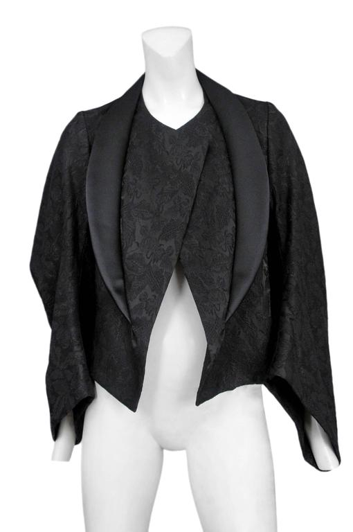 Vintage Comme des Garcons black on black brocade kimono sleeve jacket featuring a black satin collar and a voluminous side profile. Circa Autumn / Winter 2004. Please inquire for additional images.