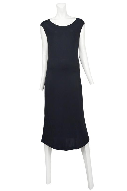 Vintage Maison Martin Margiela black rayon below the knee dress featuring cap sleeves. Please inquire for additional images.