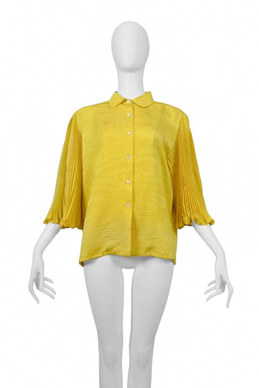 "Pierre Cardin Couture ""Yellow"" signature blouse with pleated sleeves. See swirl. Circa, 1986-1993. 
