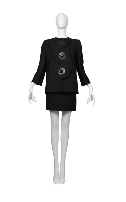 Pierre Cardin Couture black iconic suit. Leather trim at button holes. Circa, 1986-1993. Please inquire for additional images.