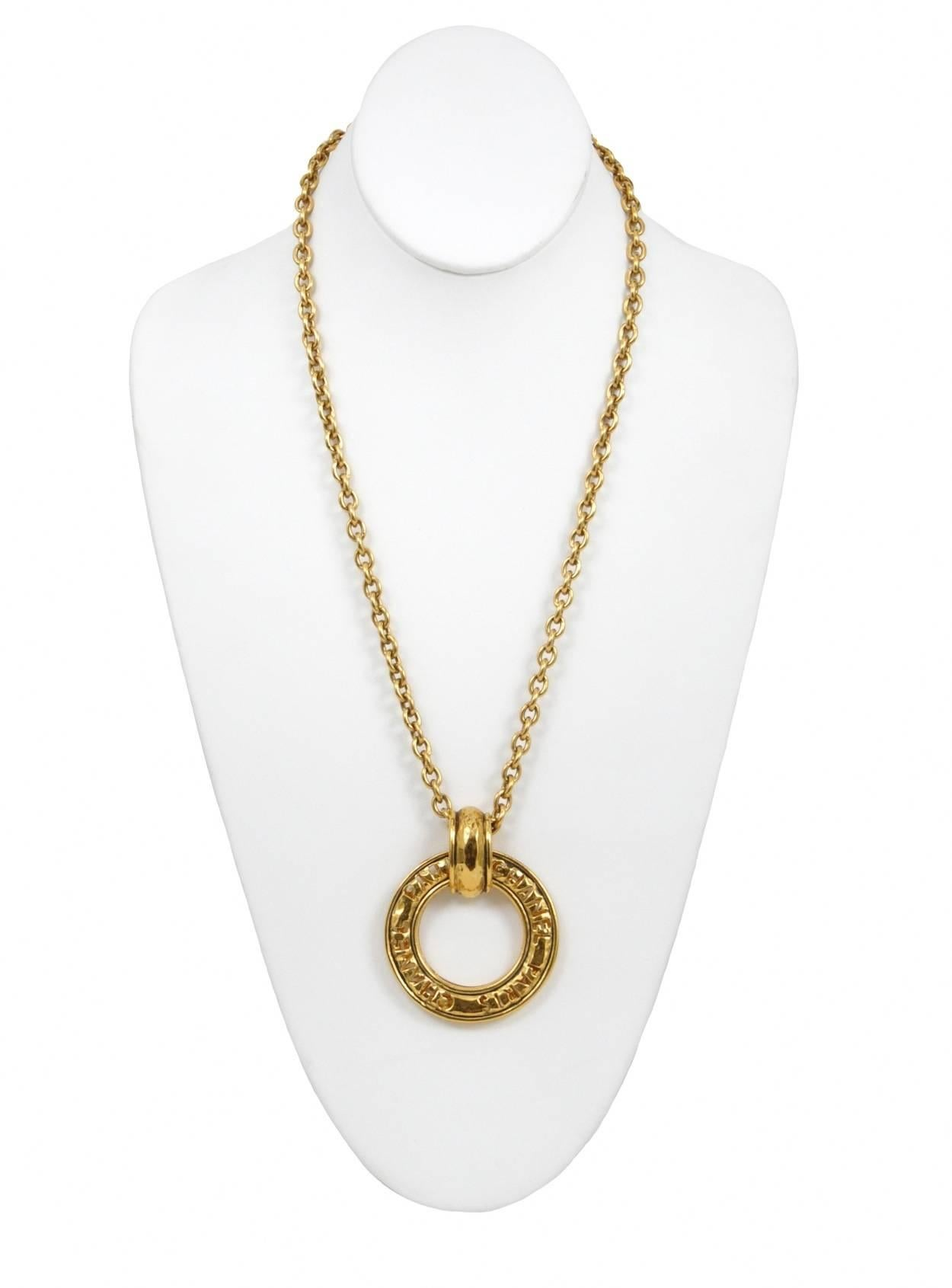 547be106a93 Chanel Gold Logo Ring Necklace For Sale at 1stdibs
