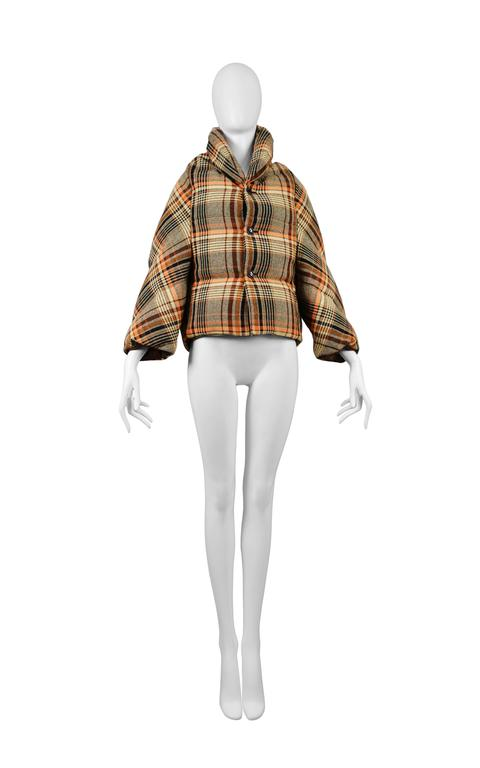 Vintage Junya Watanabe brown plaid puffer jacket featuring down stuffing and a button front closure. Circa 2004.