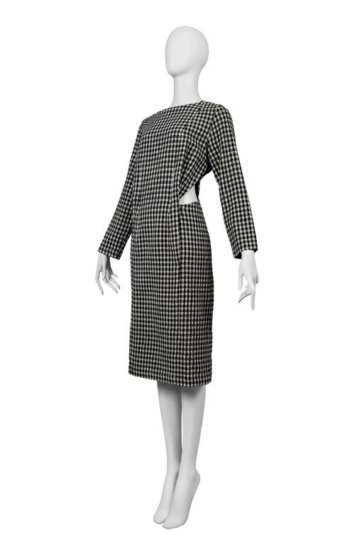 Vintage Comme des Garcons long sleeve houndstooth print dress featuring cut outs at either side of the waist. Circa 1986. Please inquire for additional images.