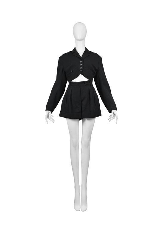 Azzedine Alaia black cropped jacket and pleated shorts ensemble. Circa, 1980's.