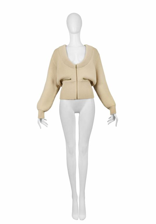 Azzedine Alaia off white knit cardigan with zipper front closure and pockets. Collection 1985.