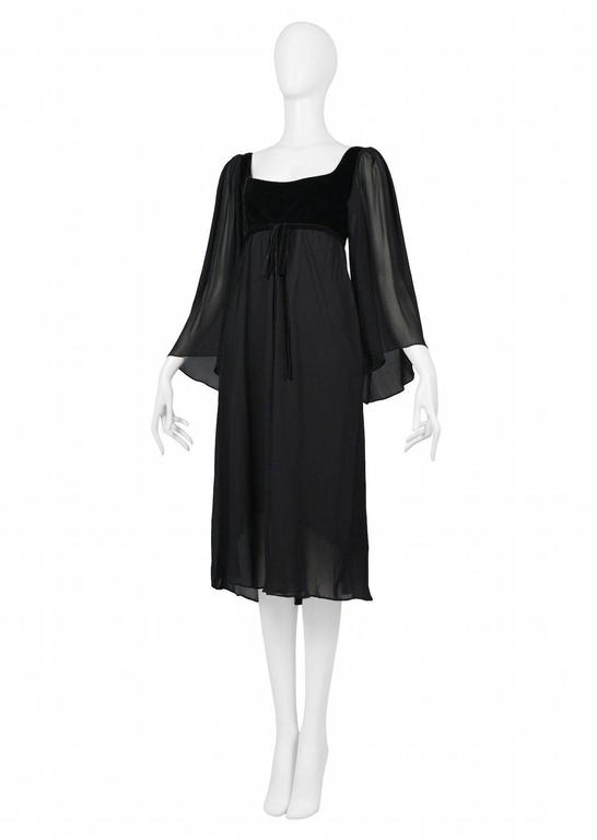 Vintage Yves Saint Laurent black empire dress featuring a black velvet bust and black chiffon body with flowing sleeves.