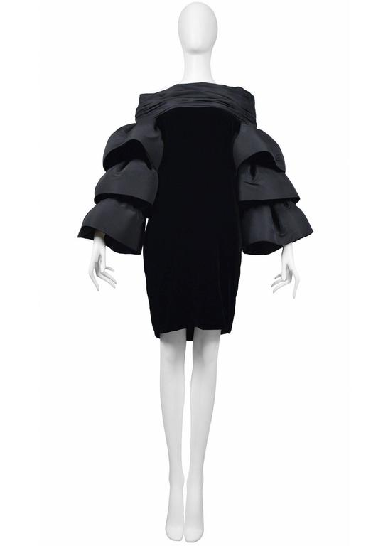 Pierre Cardin Couture black silk velvet dress with exaggerated black taffeta tiered sleeves. Strapless neckline. Circa, 1986-1993.