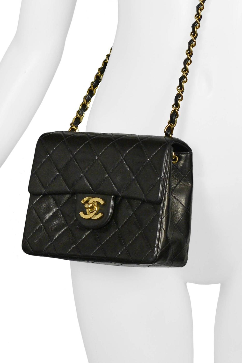 4f605eb82890b6 Vintage Chanel Classic Mini Quilted Black Leather Shoulder Bag at 1stdibs