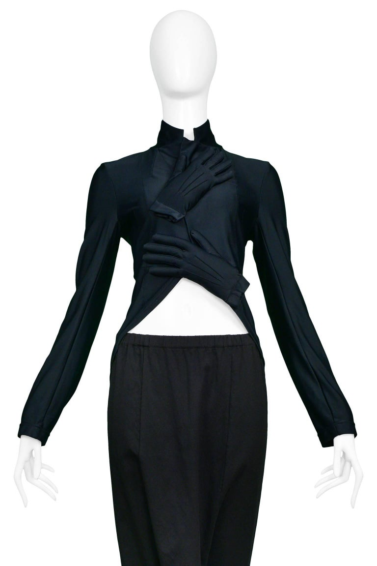 Vintage Comme des Garcons ensemble featuring an iconic black spandex padded glove top and matching black wool harem pants.