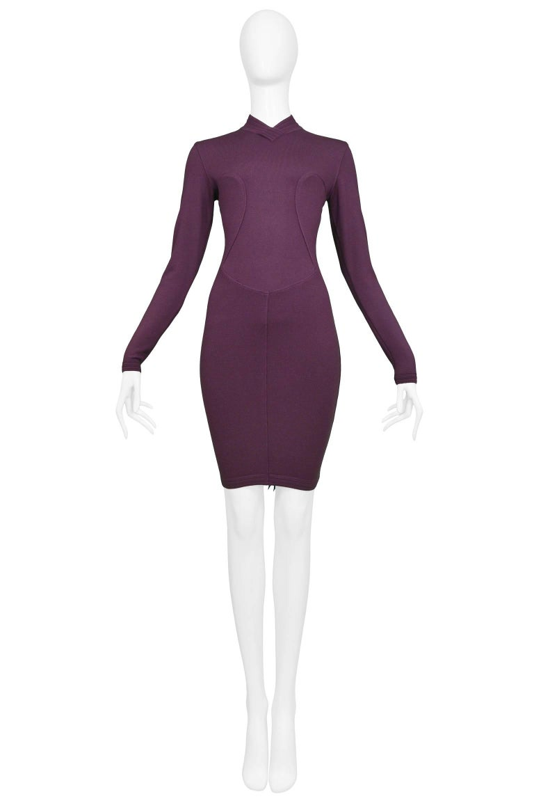 Resurrection Vintage is excited to offer a vintage Azzedine Alaia purple long sleeve body-con dress featuring a high collar neck, curved seams on the bodice, a fitted skirt and a center back zipper.   Alaia Label Size Medium Measurements: (flat