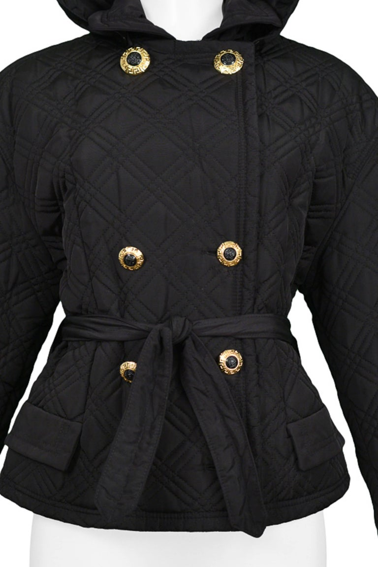 Gianni Versace vintage Versace Jeans black double breast quilted jacket with hood. Waist tie closure and gold & black classic Versace buttons.