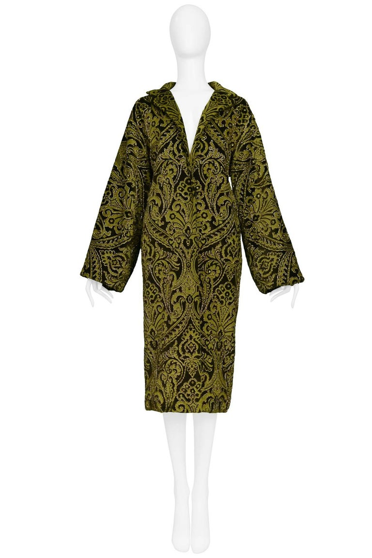 An olive and black velvet brocade Dolce & Gabbana gold beaded coat with satin lining. Featured on the runway AW 1998.