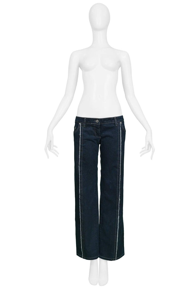 """Iconic dark blue denim Alexander McQueen """"buster"""" jeans with raw edges. Very low rise that exposes the top of the bum. Circa 1996."""
